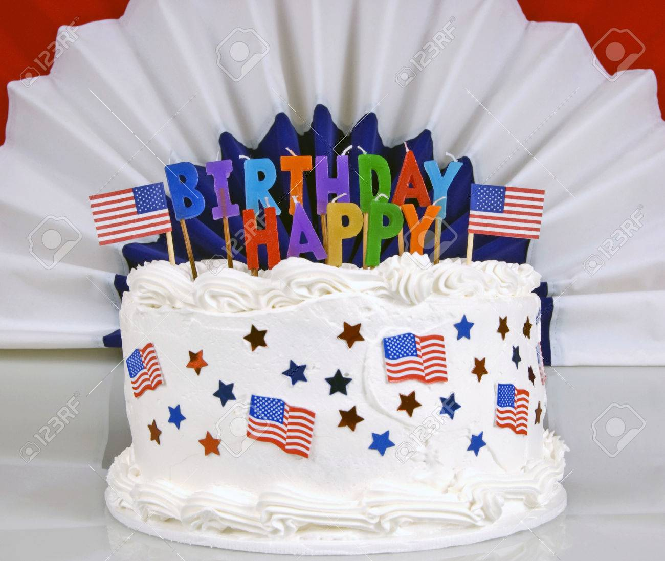 4Th Of July Birthday Cakes July 4th Birthday Cake With Patriotic Banner In Background Stock