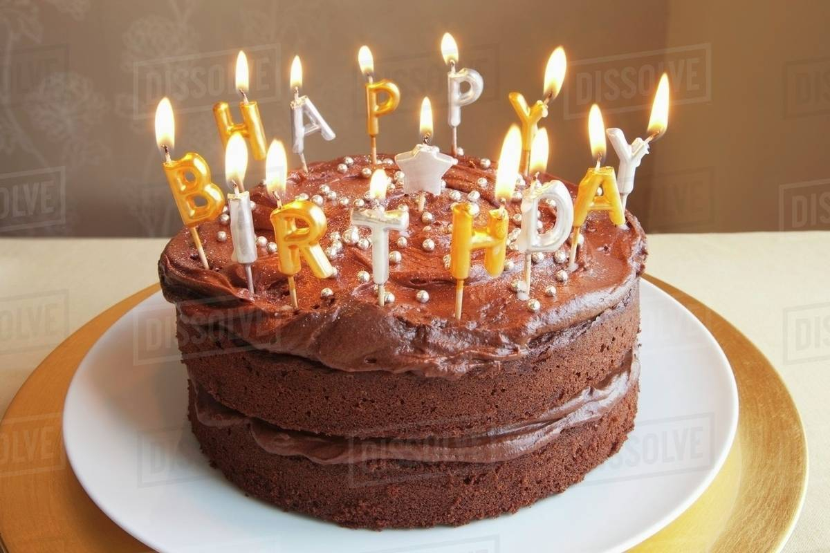 Birthday Cake With Lots Of Candles A Chocolate Birthday Cake With Lots Of Candles Stock Photo Dissolve