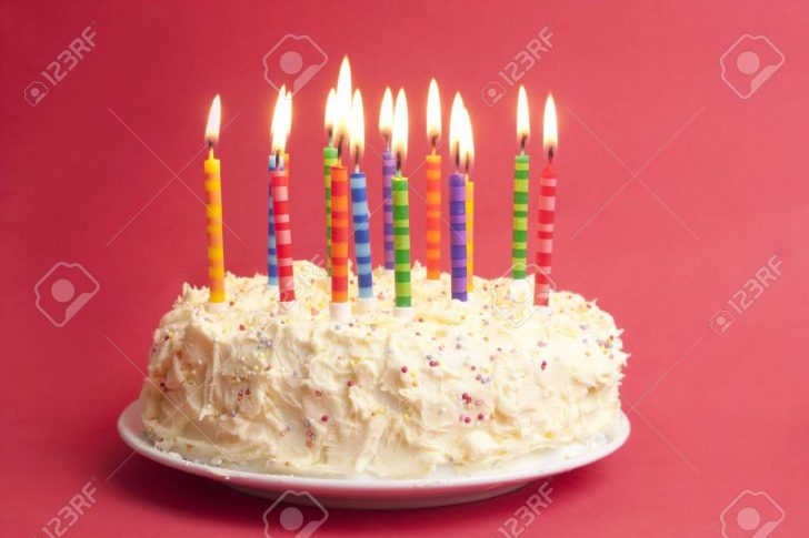 Birthday Cake With Lots Of Candles Birthday Cake With Lots Of Candles On A Red Background Stock Photo