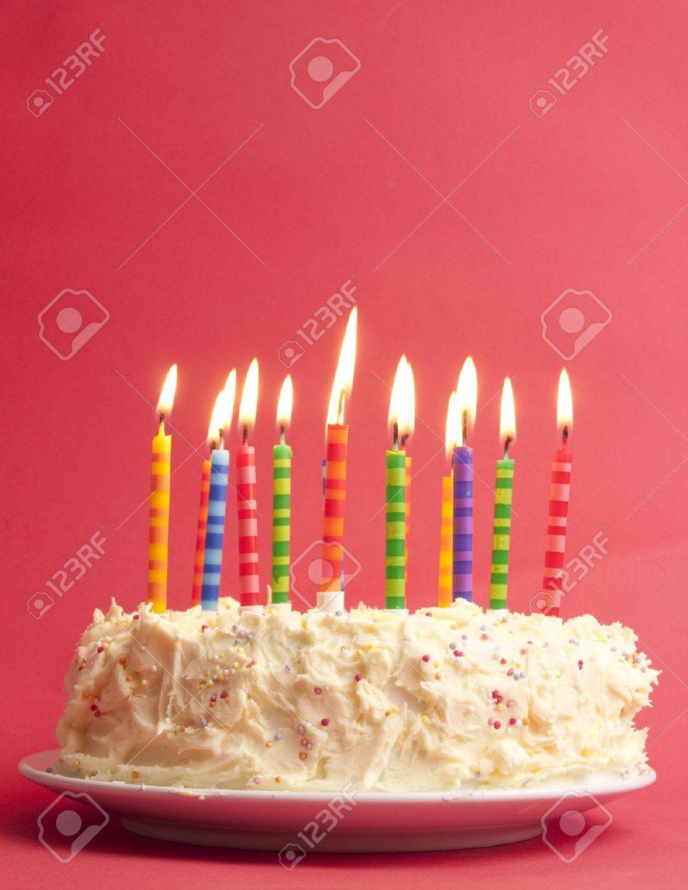 Birthday Cake With Lots Of Candles Birthday Cake With Lots Of Cute Striped Candles Shot On A Red