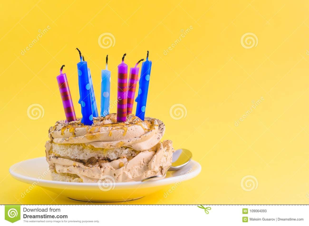Birthday Cake With Lots Of Candles Chocolate Cake With Cream And Lots Of Candles On A Yellow Background