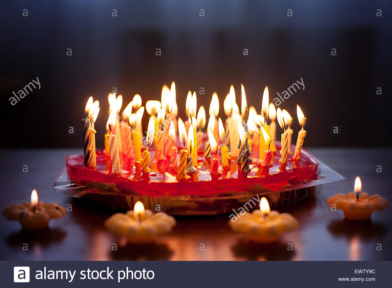 Birthday Cake With Lots Of Candles Strawberry Cake With Lots Of Candles On A Table Stock Photo