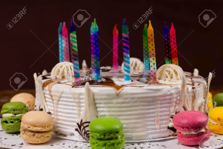 Birthday Cake With Lots Of Candles White Birthday Cake With Lots Of Colored Candles Near Different