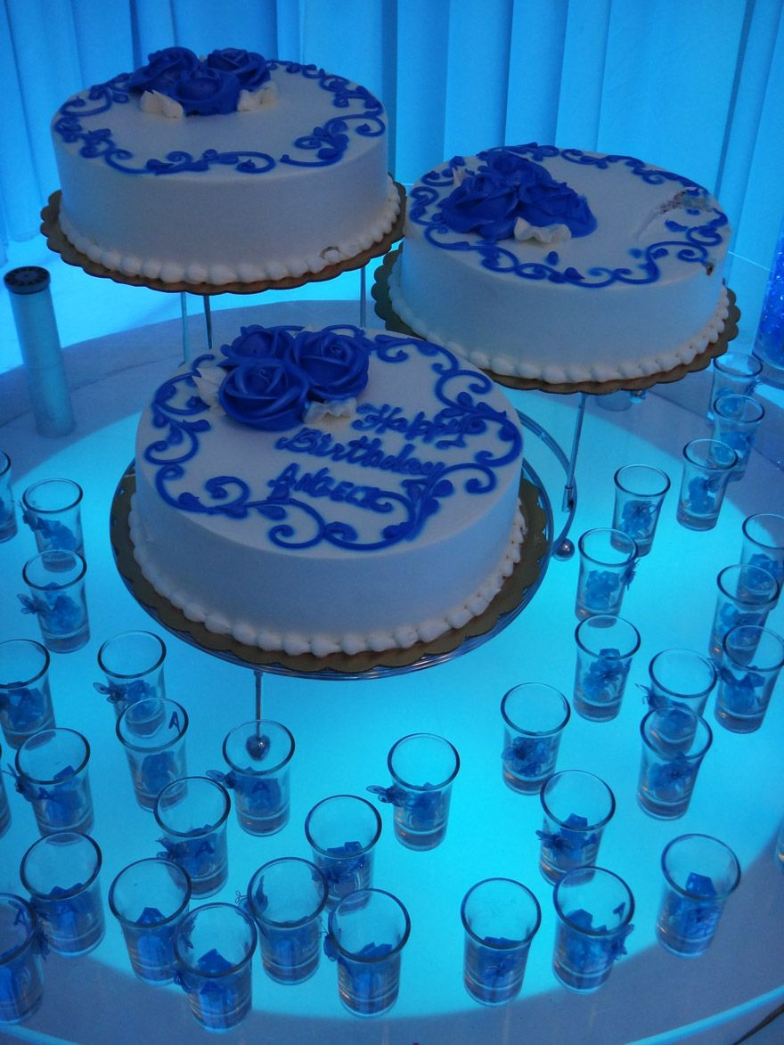 Blue And White Birthday Cake Three Blue And White Birthday Cakes With Candles Around At Royal