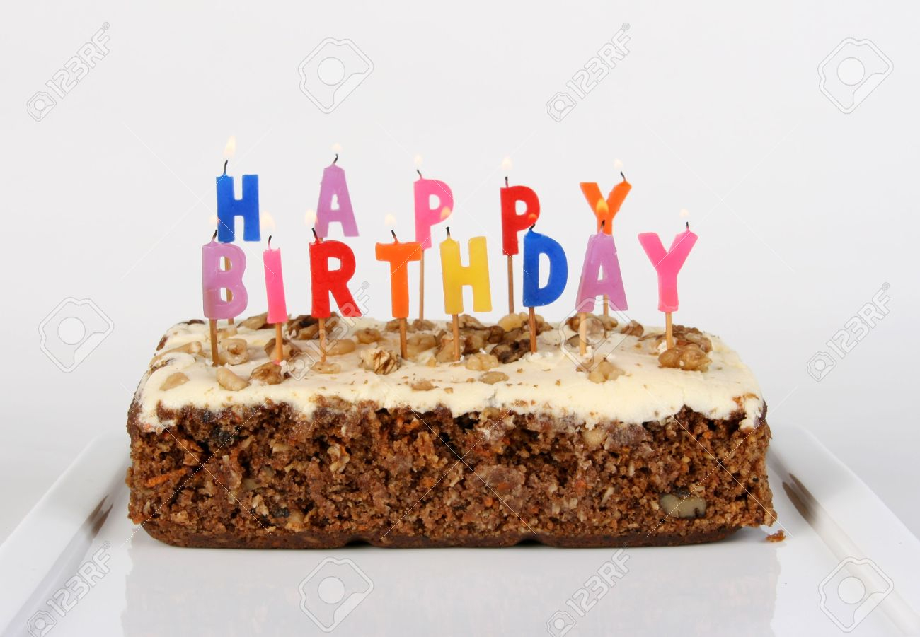 Carrot Cake Birthday Cake Birthday Cake Candles Lit On A Carrot Cake Stock Photo Picture And
